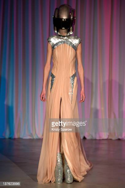 A model walks the runway during the Jantaminiau HauteCouture 2012 show as part of Paris Fashion Week at Le Laboratoire on January 23 2012 in Paris...