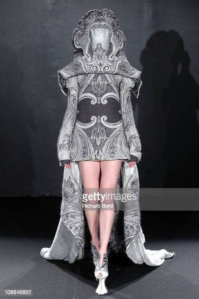 A model walks the runway during the Jantaminiau show as part of the Paris Haute Couture Fashion Week Spring/Summer 2011 at Le Laboratoire on January...
