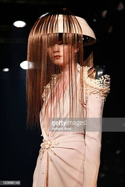 A model walks the runway during the Jantaminiaushow as part of Paris Fashion Week Fall/Winter 2011 at BETC EURO RSCG on July 7 2010 in Paris France