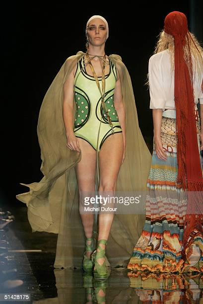 A model walks the runway during the Jean Paul Gaultier fashion show as part of Paris Fashion Week Spring/Summer 2005 October 5 2004 in Paris France