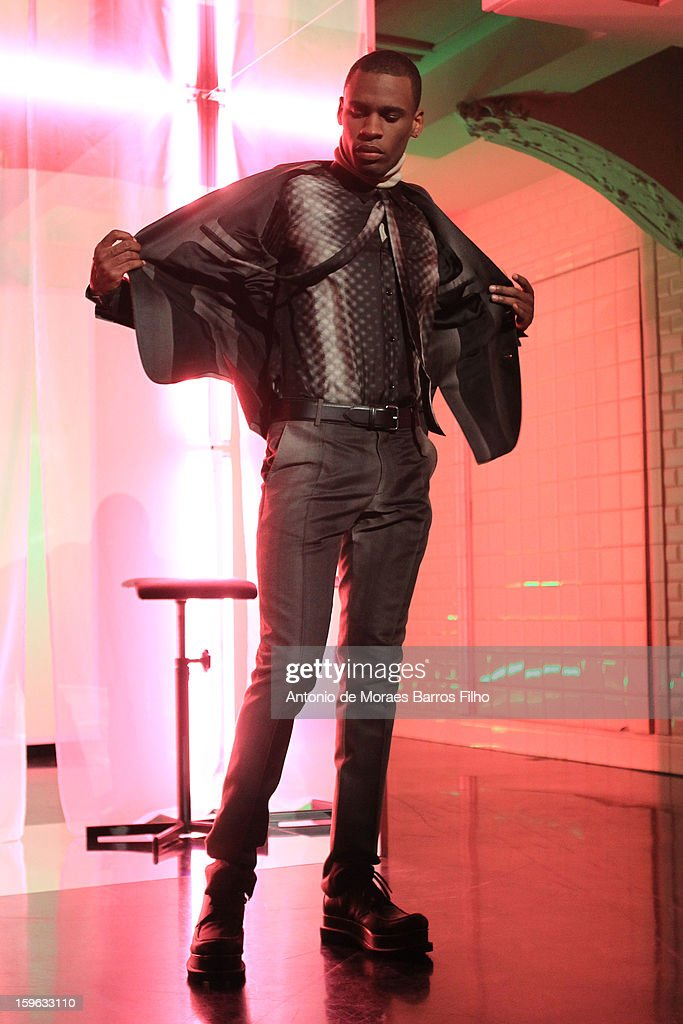A model walks the runway during the Jean Paul Gaultier Men Autumn / Winter 2013 show as part of Paris Fashion Week.