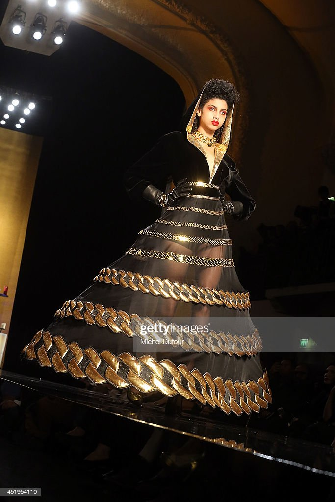 A model walks the runway during the Jean Paul Gaultier show as part of Paris Fashion Week - Haute Couture Fall/Winter 2014-2015 at 325 Rue Saint Martin on July 9, 2014 in Paris, France.