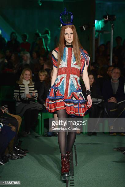 A model walks the runway during the Jean Paul Gaultier show as part of the Paris Fashion Week Womenswear Fall/Winter 20142015 on March 1 2014 in...