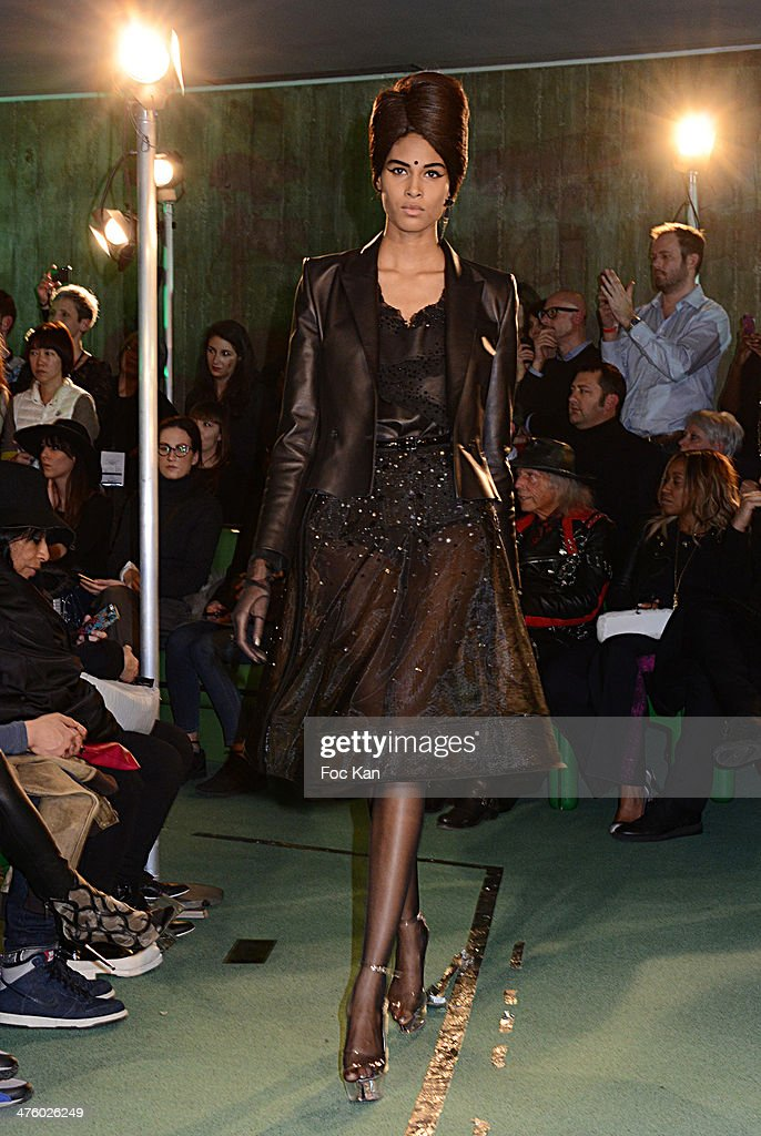 A model walks the runway during the Jean Paul Gaultier Show as part of the Paris Fashion Week Womenswear Fall/Winter 2014-2015 at Espace Oscar Niemayer on March 01, 2014 in Paris, France.