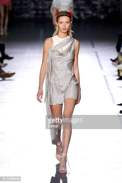 A model walks the runway during the John Galliano designed by Bill Gaytten show as part of the Paris Fashion Week Womenswear Spring/Summer 2017 on...