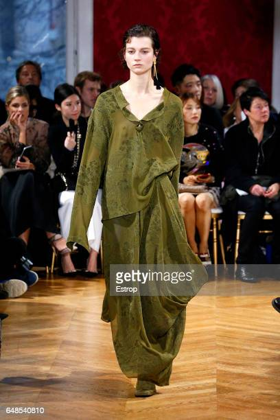 A model walks the runway during the John Galliano designed by Bill Gaytten show as part of the Paris Fashion Week Womenswear Fall/Winter 2017/2018 on...