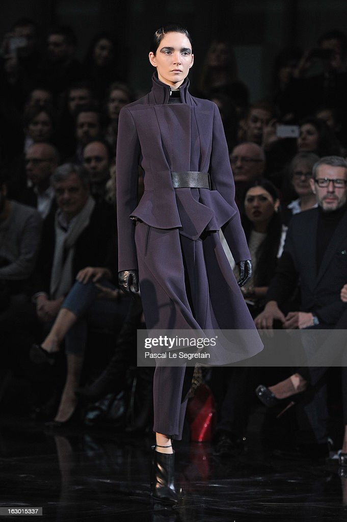 A model walks the runway during the John Galliano Fall/Winter 2013 Ready-to-Wear show as part of Paris Fashion Week at Le Centorial on March 3, 2013 in Paris, France.