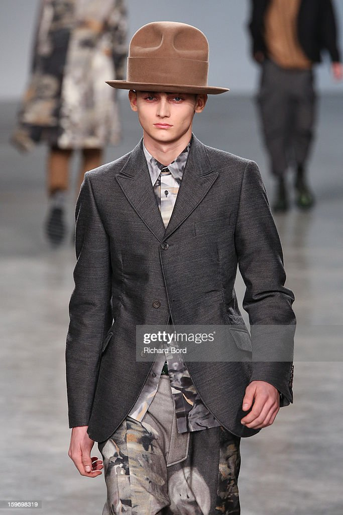 A model walks the runway during the John Galliano Men Autumn / Winter 2013 show as part of Paris Fashion Week on January 18, 2013 in Paris, France.