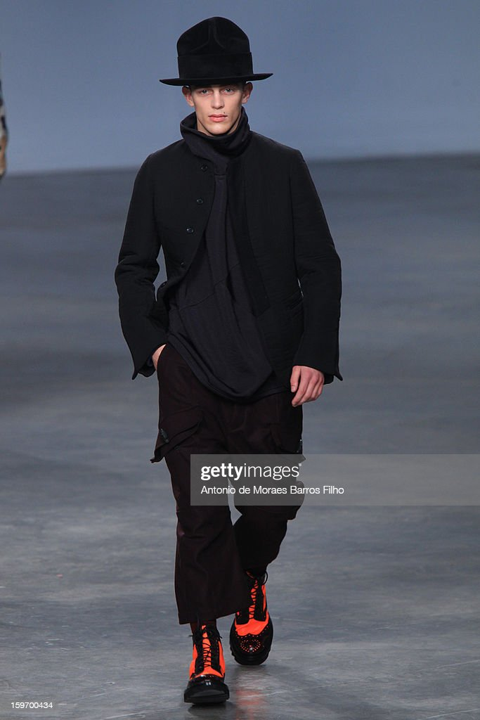 A model walks the runway during the John Galliano Men Autumn / Winter 2013 show as part of Paris Fashion Week on at Palais De Tokyo on January 18, 2013 in Paris, France.