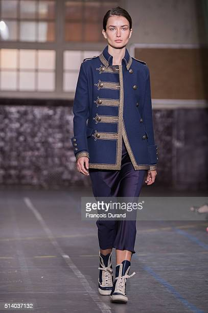 A model walks the runway during the John Galliano show as part of the Paris Fashion Week Womenswear Fall/Winter 2016/2017 on March 6 2016 in Paris...
