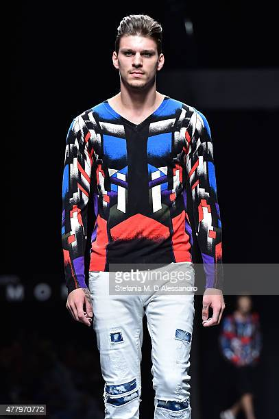 A model walks the runway during the John Richmond fashion show as part of Milan Men's Fashion Week Spring/Summer 2016 on June 21 2015 in Milan Italy