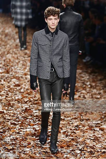 A model walks the runway during the John Varvatos Show as a part of Milan Menswear Fashion Week Fall Winter 2015/2016 on January 17 2015 in Milan...