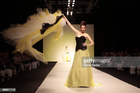A model walks the runway during the Jordi Dalmau fashion show as part of 'Barcelona Bridal Week 2014' on May 8 2014 in Barcelona Spain
