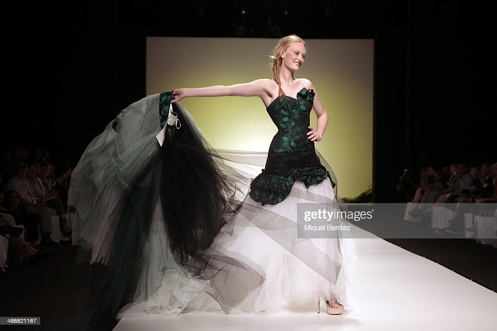 A model walks the runway during the Jordi Dalmau fashion show as part of 'Barcelona Bridal Week 2014' on May 8, 2014 in Barcelona, Spain.