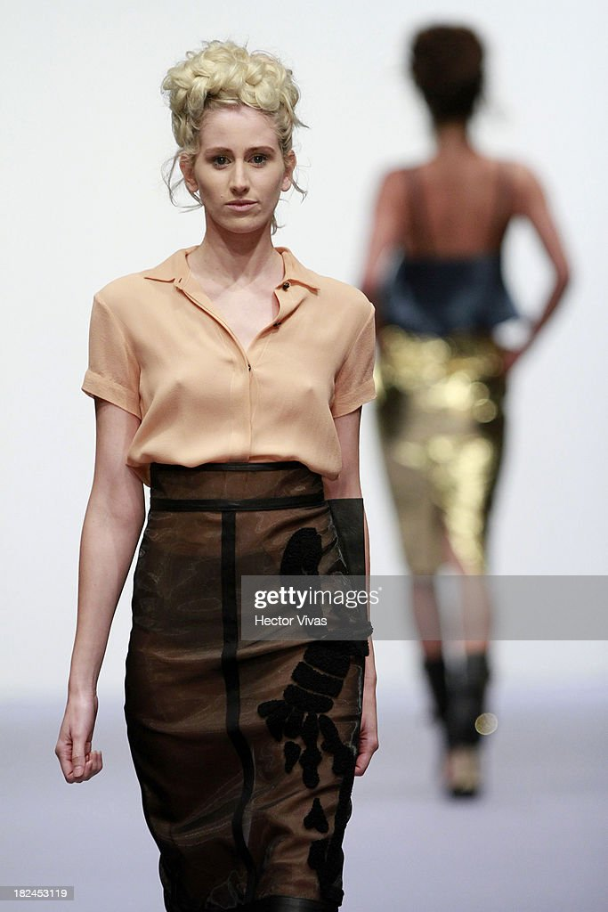 A model walks the runway during the Jorge Duque show at Mercedes Benz Fashion Week Mexico 2013 on September 29, 2013 in Mexico City, Mexico.