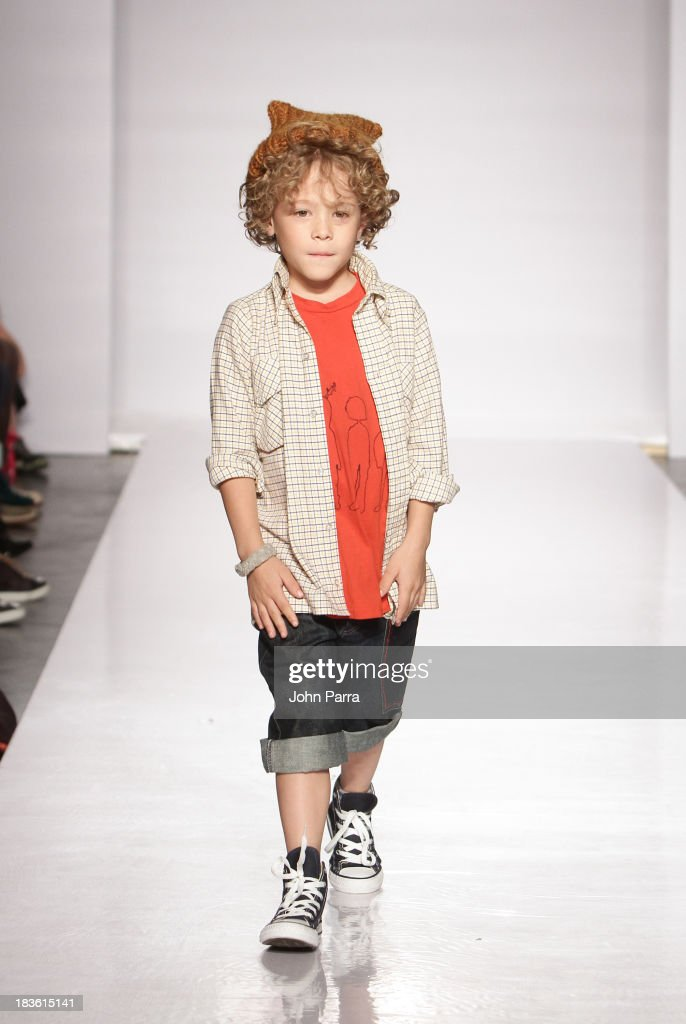 A model walks the runway during the Julia Passafiume preview at the Parsons The School For Design at petiteParade NY Kids Fashion Week in Collaboration with VOGUEbambini at Industria Superstudio on October 5, 2013 in New York City.