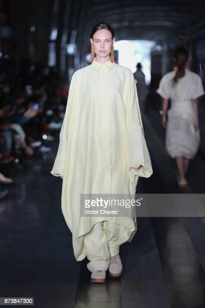 A model walks the runway during the Julia y Renata show at Mercedes Benz Fashion Week Mexico Spring/Summer 2018 at Estacion Buena Vista on November...