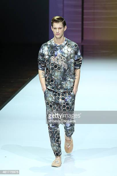 A model walks the runway during the Julian Zigerli show as a part of Milan Fashion Week Menswear Autumn/Winter 2014 on January 11 2014 in Milan Italy