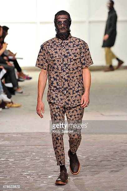 A model walks the runway during the Julien David Menswear Spring/Summer 2016 show as part of Paris Fashion Week on June 25 2015 in Paris France