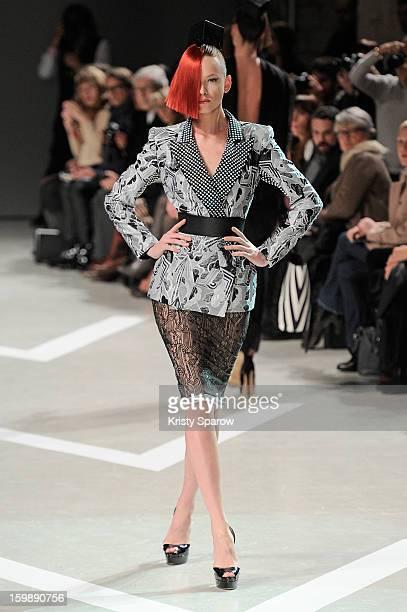 A model walks the runway during the Julien Fournie Spring/Summer 2013 HauteCouture show as part of Paris Fashion Week at Cite de l'Architecture et du...