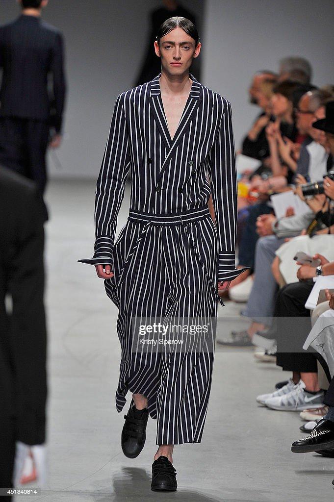 A model walks the runway during the Juun J show as part of Paris Fashion Week Menswear Spring/Summer 2015 on June 27, 2014 in Paris, France.