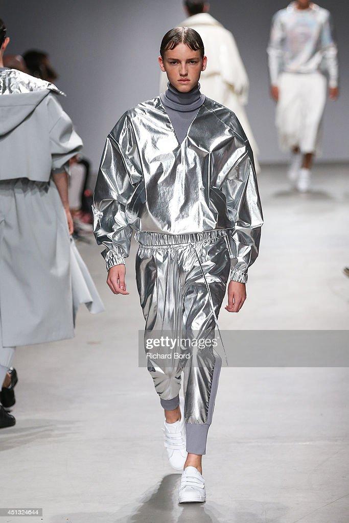 A model walks the runway during the Juun J show as part of the Paris Fashion Week Menswear Spring/Summer 2015 at Palais de Tokyo on June 27, 2014 in Paris, France.