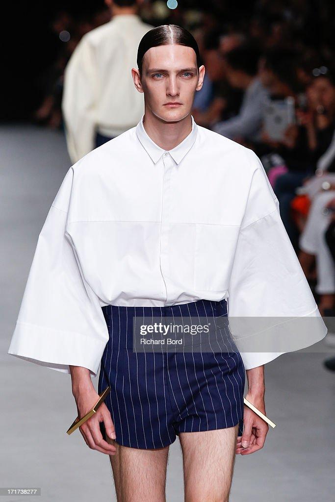 A model walks the runway during the Juun.J Menswear Spring/Summer 2014 show at Palais de Tokyo as part of the Paris Fashion Week on June 28, 2013 in Paris, France.
