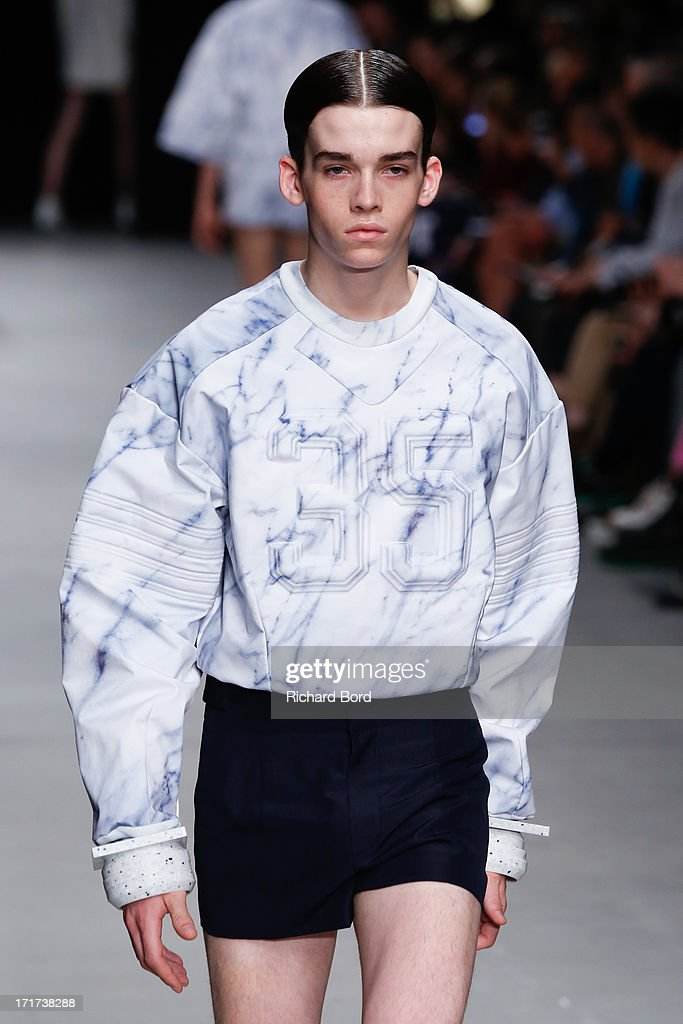 A model walks the runway during the Juun.J Menswear Spring/Summer 2014 show at Palais de Tokyo as part of the Paris Fashion Week on June 28, 2013 in Paris, France.