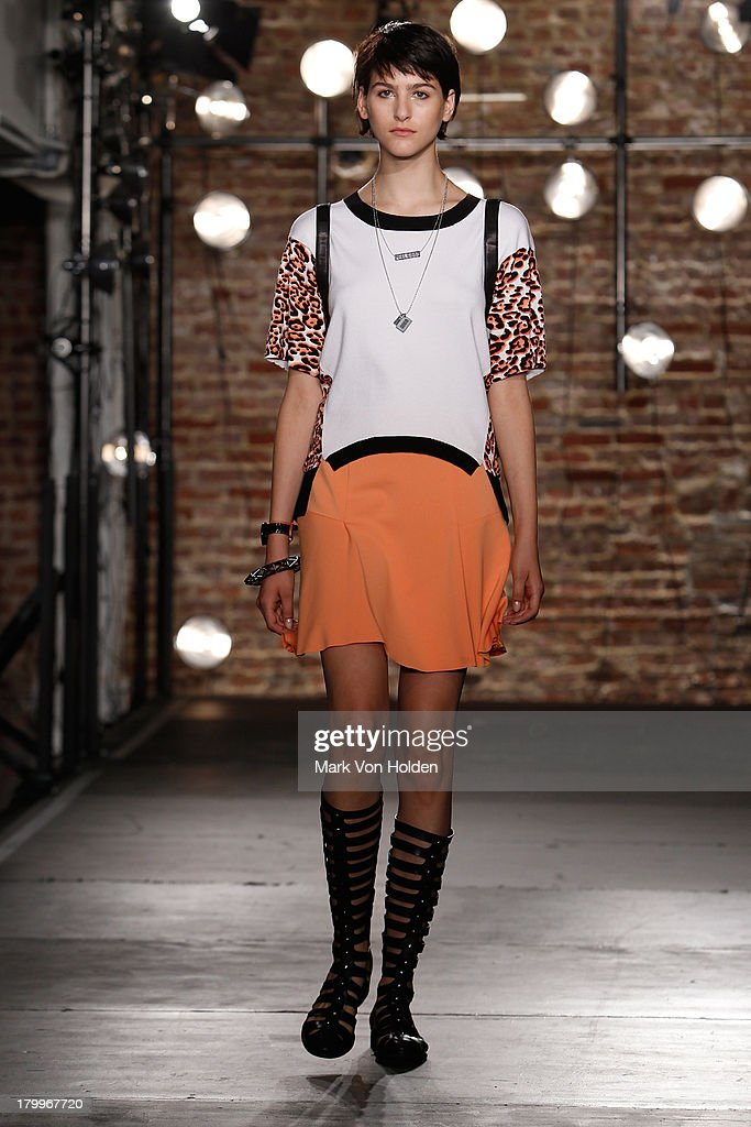 A model walks the runway during the Kenneth Cole Collection Presentation during Mercedes-Benz Fashion Week Spring 2014 on September 7, 2013 in New York City.
