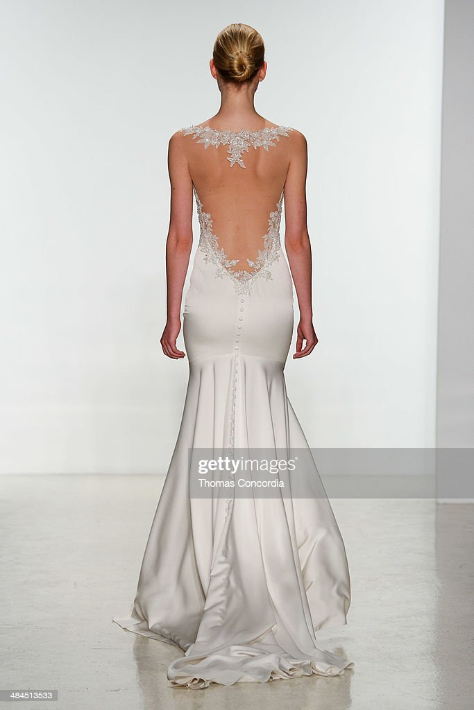 A model walks the runway during the Kenneth Pool Spring 2015 Bridal collection show at EZ Studios on April 12, 2014 in New York City.