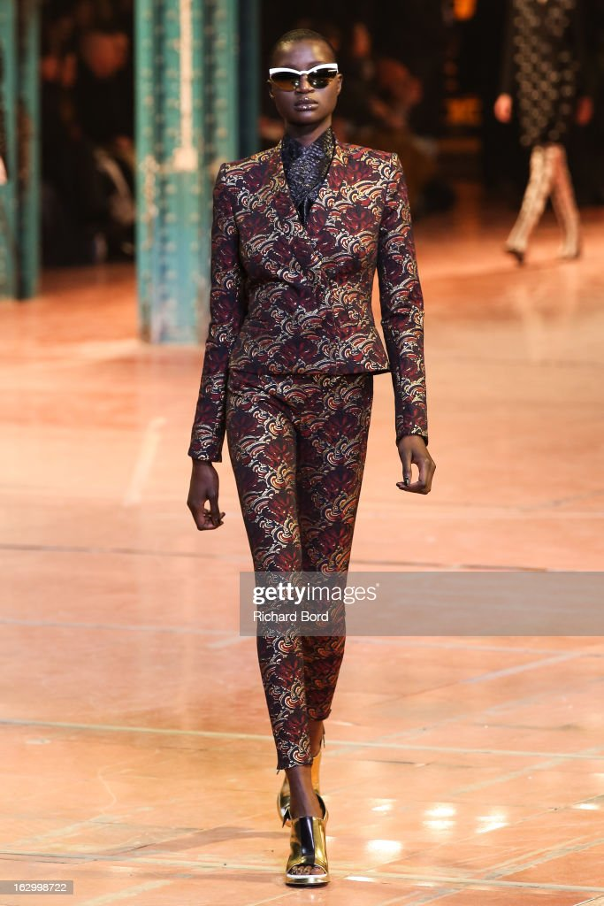 A model walks the runway during the Kenzo Fall/Winter 2013 Ready-to-Wear show as part of Paris Fashion Week at La Samaritaine on March 3, 2013 in Paris, France.