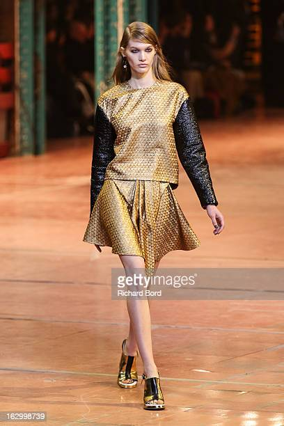 A model walks the runway during the Kenzo Fall/Winter 2013 ReadytoWear show as part of Paris Fashion Week at La Samaritaine on March 3 2013 in Paris...