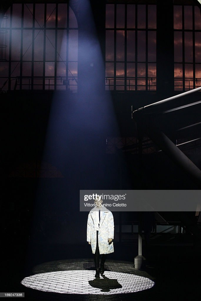 A model walks the runway during the Kenzo fashion show as part of Pitti Immagine Uomo 83 at Mercato Centrale on January 10, 2013 in Florence, Italy.
