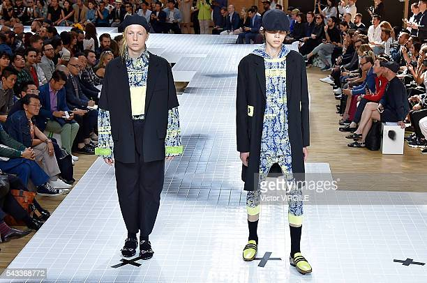A model walks the runway during the Kenzo Menswear Spring/Summer 2017 show as part of Paris Fashion Week on June 25 2016 in Paris France