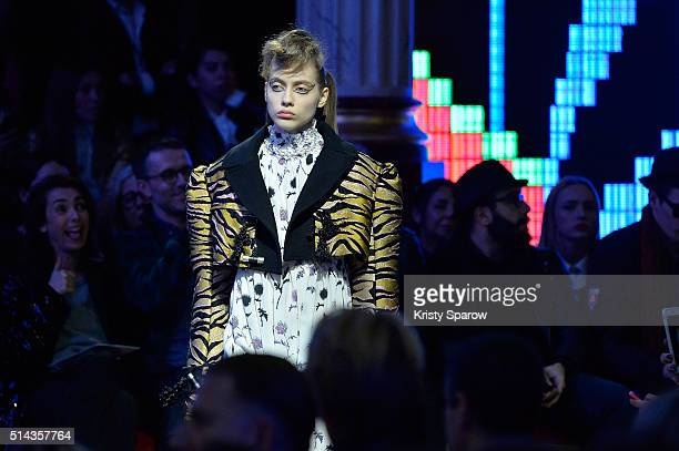 A model walks the runway during the Kenzo show as part of Paris Fashion Week Womenswear Fall/Winter 2016/2017 on March 8 2016 in Paris France