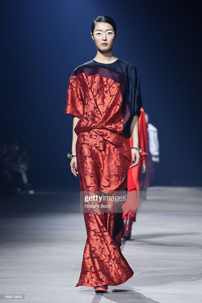 A model walks the runway during the Kenzo show as part of the Paris Fashion Week Womenswear Fall/Winter 2015/2016 at Paris Event Center on March 8...