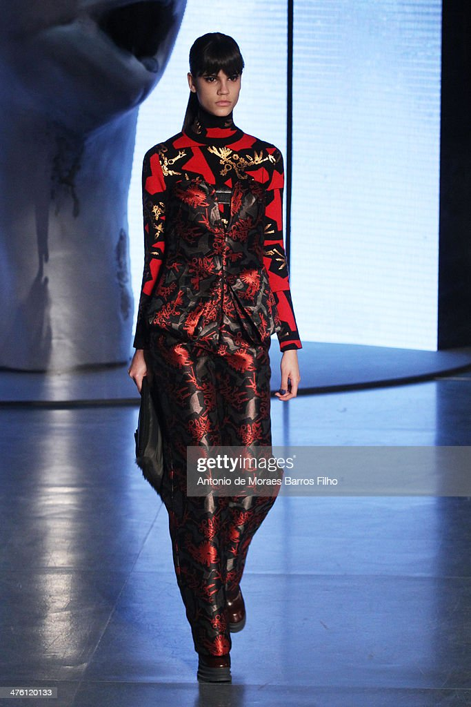 A model walks the runway during the Kenzo show as part of the Paris Fashion Week Womenswear Fall/Winter 2014-2015 on March 2, 2014 in Paris, France.