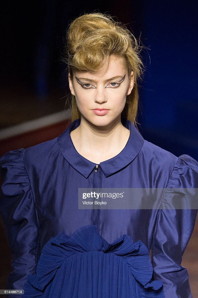A model walks the runway during the Kenzo show as part of the Paris Fashion Week Womenswear Fall/Winter 2016/2017 on March 8 2016 in Paris France