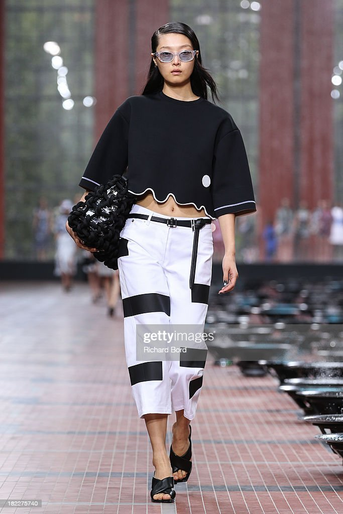 A model walks the runway during the Kenzo show at 'Cite du Cinema' of Saint-Denis as part of the Paris Fashion Week Womenswear Spring/Summer 2014 on September 29, 2013 in Paris, France.