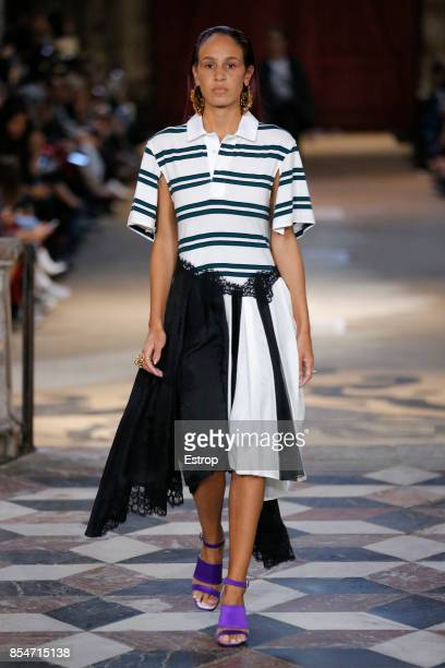 A model walks the runway during the Koche show as part of the Paris Fashion Week Womenswear Spring/Summer 2018 on September 26 2017 in Paris France