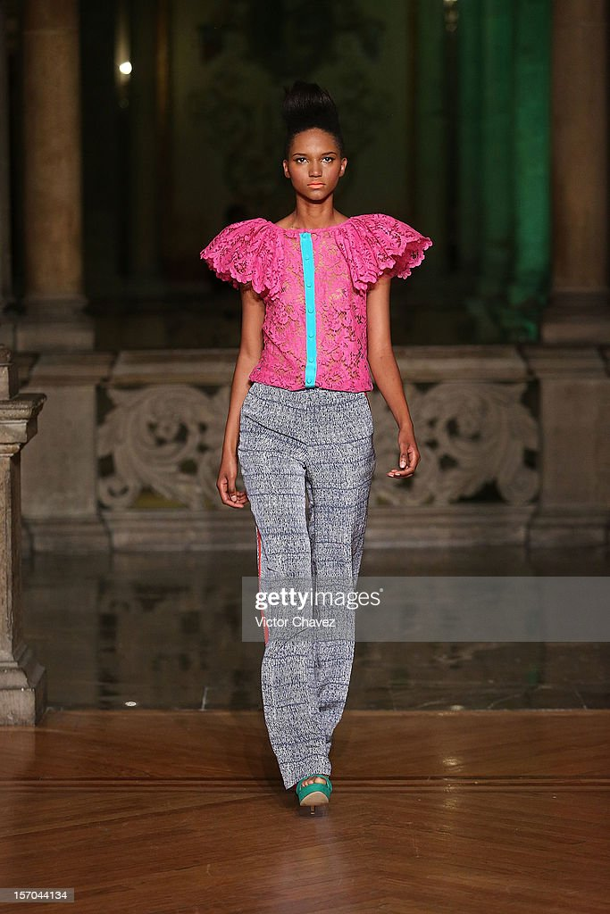 A model walks the runway during the Kris Goyri Spring/Summer 2013 fashion show at Casino Español on November 27, 2012 in Mexico City, Mexico.