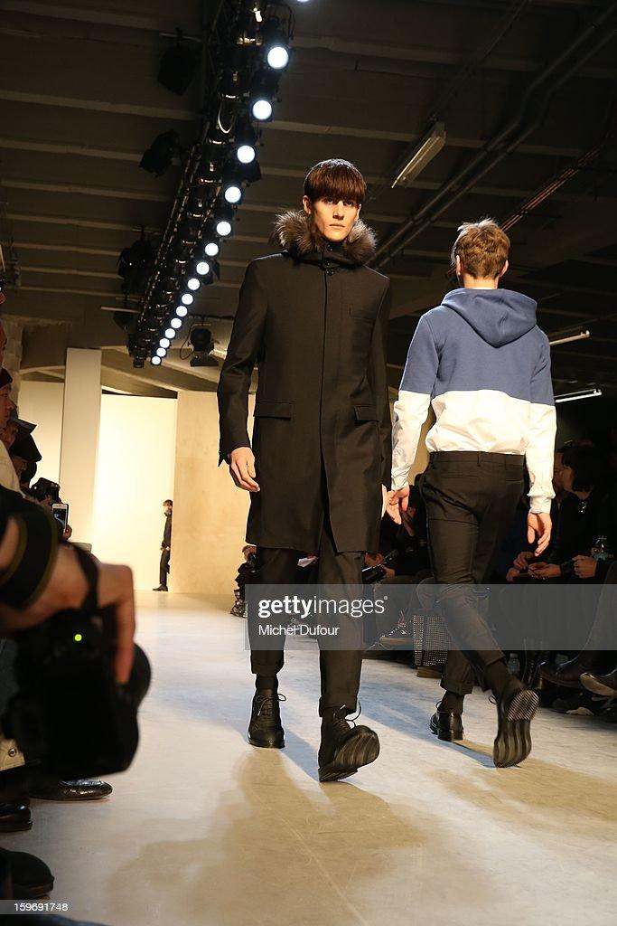 A model walks the runway during the Krisvanassche Men Autumn / Winter 2013 show as part of Paris Fashion Week on at Palais De Tokyo on January 18, 2013 in Paris, France.
