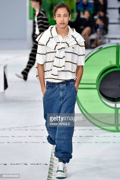 A model walks the runway during the Lacoste Ready to Wear Spring/Summer 2018 fashion show as part of the Paris Fashion Week Womenswear Spring/Summer...