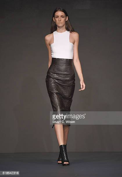 A model walks the runway during the Lama Jouni show at Fashion Forward Fall/Winter 2016 held at the Dubai Design District on April 1 2016 in Dubai...