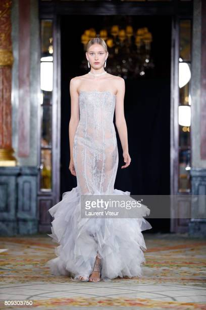 A model walks the runway during the Lan Yu Haute Couture Fall/Winter 20172018 show as part of Haute Couture Paris Fashion Week on July 5 2017 in...