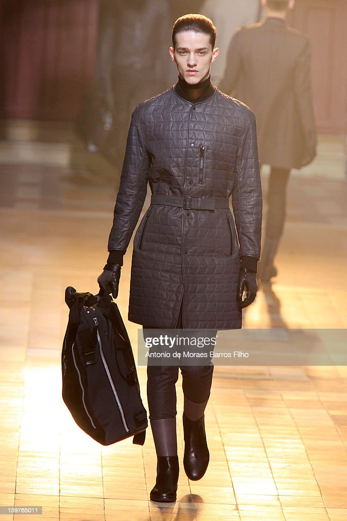 A model walks the runway during the Lanvin Men Autumn / Winter 2013 show as part of Paris Fashion Week on at on January 20, 2013 in Paris, France.