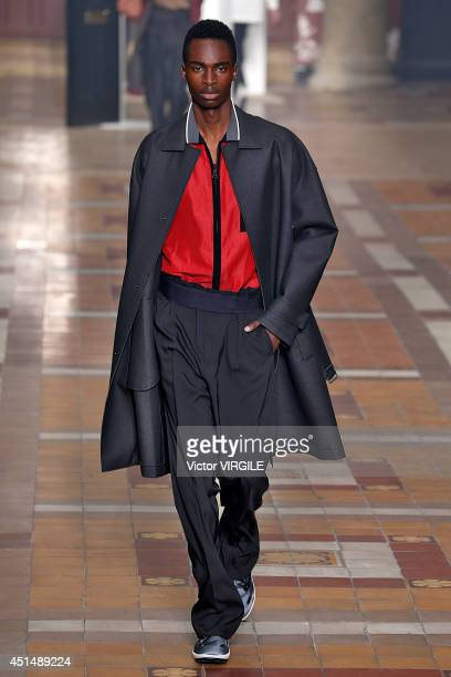 A model walks the runway during the Lanvin show as part of the Paris Fashion Week Menswear Spring/Summer 2015 on June 29 2014 in Paris France