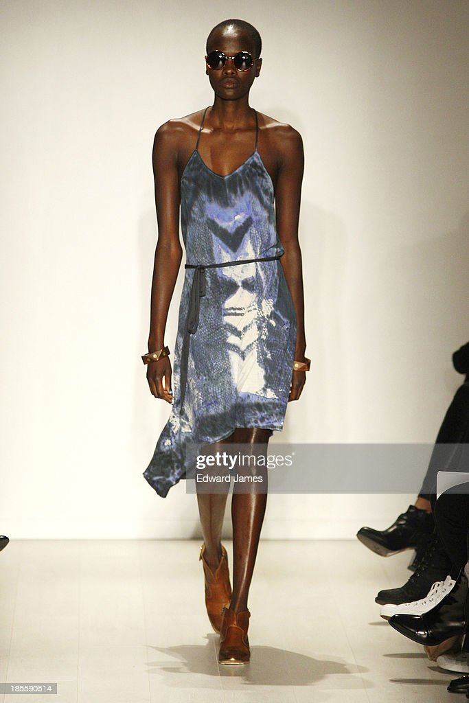 A model walks the runway during the Laura Siegel fashion show at David Pecaut Square on October 22, 2013 in Toronto, Canada.