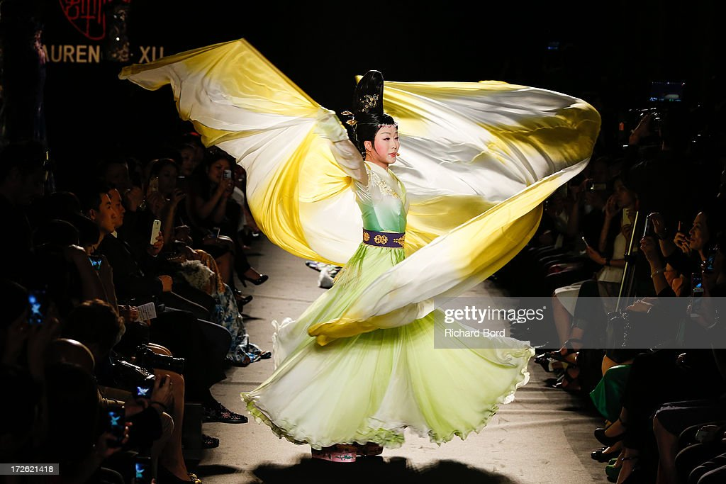 A model walks the runway during the Laurence Xu show as part of Paris Fashion Week Haute-Couture Fall/Winter 2013-2014 at Pavillon Cambon on July 4, 2013 in Paris, France.