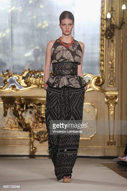 A model walks the runway during the Les Copains show as a part of Milan Fashion Week Womenswear Spring/Summer 2015 on September 19 2014 in Milan Italy